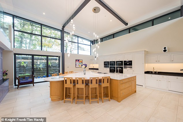 The vast interior space includes an eight seater island in the kitchen