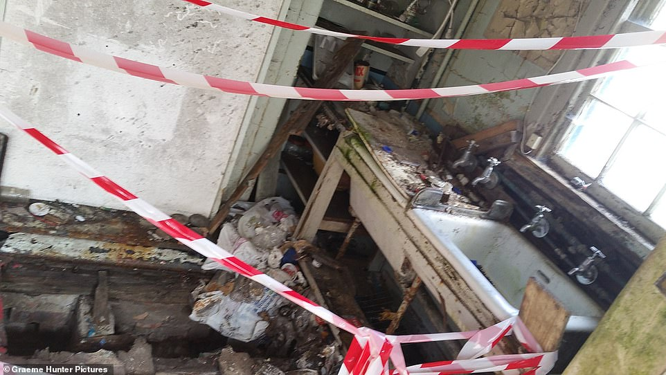 The kitchen was a no-go area with emergency tape to stop you from entering, so you didn't fall through what was left of floorboards