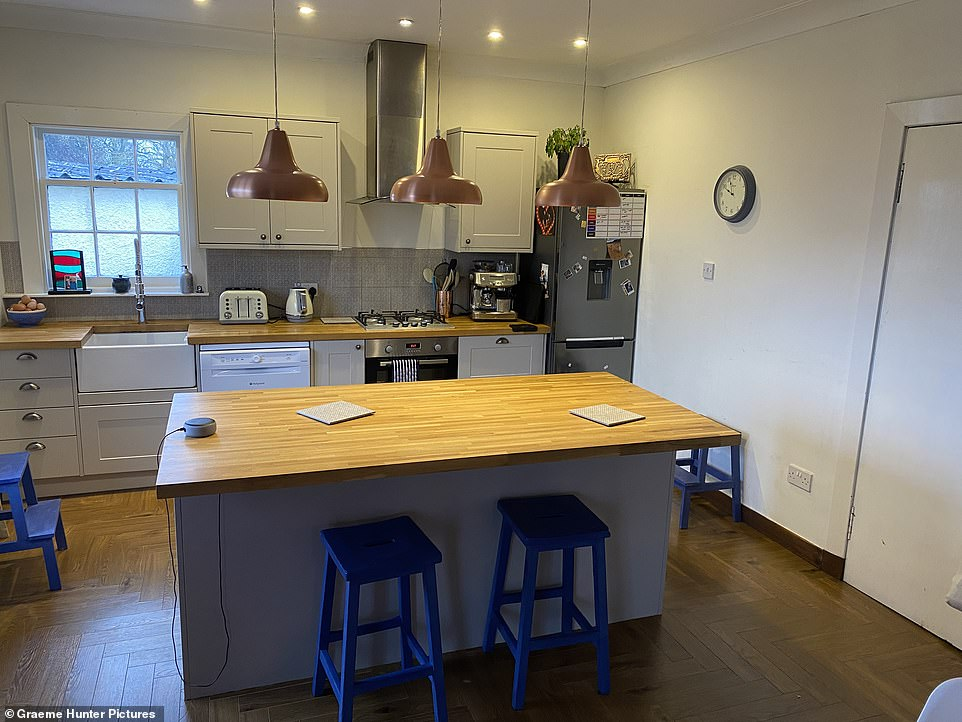 My favourite room is the kitchen-diner, which has a wood burner. Downstairs is all open plan but rooms can be closed off