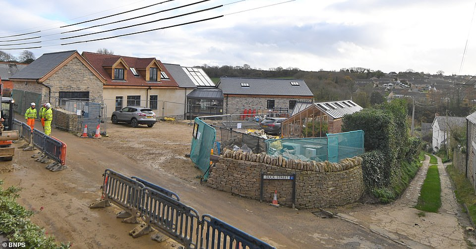 Some homeowners have complained that their picturesque countryside views have been blocked by the controversial house which is also said to be too overbearing for the small village which is in an Area of Outstanding Natural Beauty