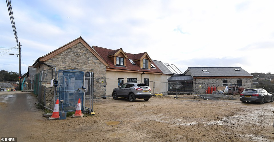 The large Y-shaped property that has a two storey organgery now dwarfs a row of 18th century cottages opposite