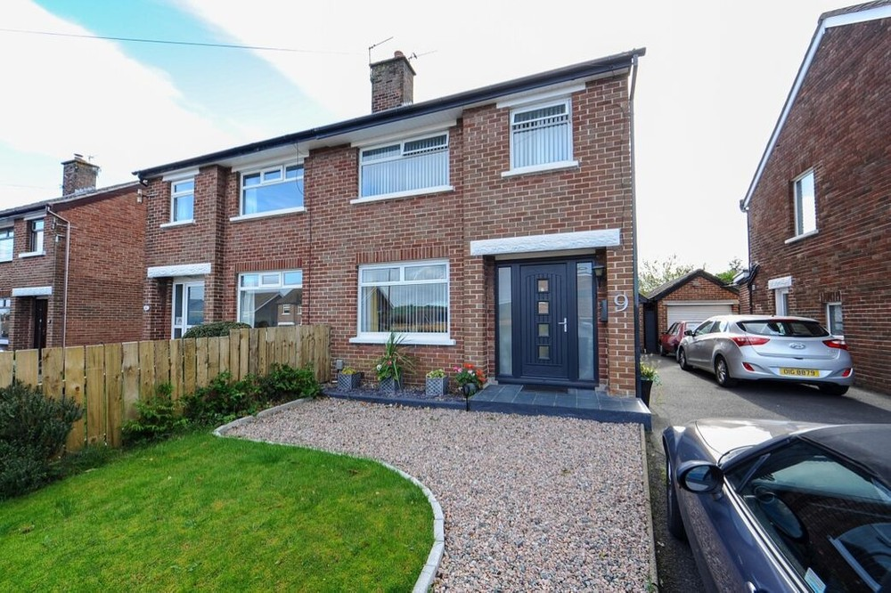 The exterior of 9 South Sperrin. This is a semi-detached property in East Belfast. A tarmac driveway leads to the right of the property.
