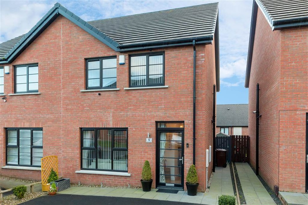 The exterior of 5 Highgrove Crescent. This is a semi-detached house for sale in Carrickfergus.