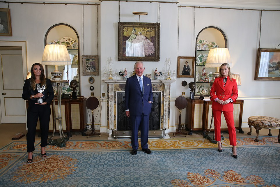 Pictured, Prince Charles with Rebecca Beattie (left) and Laura Whitmore (right) in the Morning Room on 27 October 2020