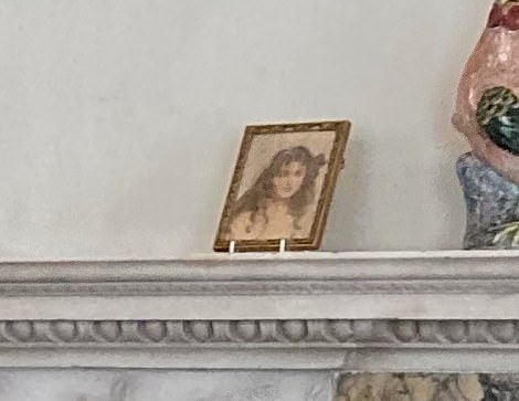 The small portrait on the mantelpiece is of the then Lady Elizabeth Bowes-Lyon, by Mabel Hankey, dating back to 1908 (pictured)