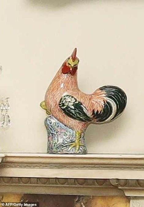 The porcelain cockerel that once belonged to Queen Mary has been placed back on the mantelpiece