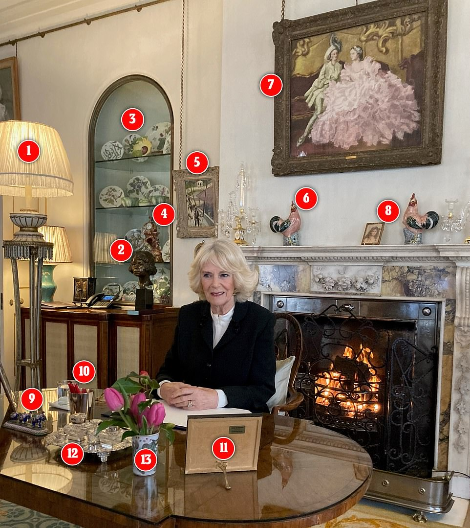 The Duchess of Cornwall, Patron of SafeLives, offered a detailed look into the Morning Room at Clarence House as she spoke with the Charity's Chief Executive during a video call today. Pictured: 1. Mid-eighteenth century giltwood pedestal with lights 2. A bust of the young Queen 3. Chelsea botanical porcelain collection 4. An eighteenth-century porcelain mantelpiece clock 5. Sortie de l'Eglise, Jamaique, a 1961 painting by Sir Noël Coward 6. Porcelain cockerel that once belonged to Queen Mary 7. Lady in a Pink Ballgown with Gentleman in Green by Walter Sickert 8. The then Lady Elizabeth Bowes-Lyon, by Mabel Hankey, dating back to 1908, 8. Trio of blue ornamental elephants, 10. Silver tub filled with red pens, 11. Framed photograph, 12.Silver tray, 13.Jug of tulips