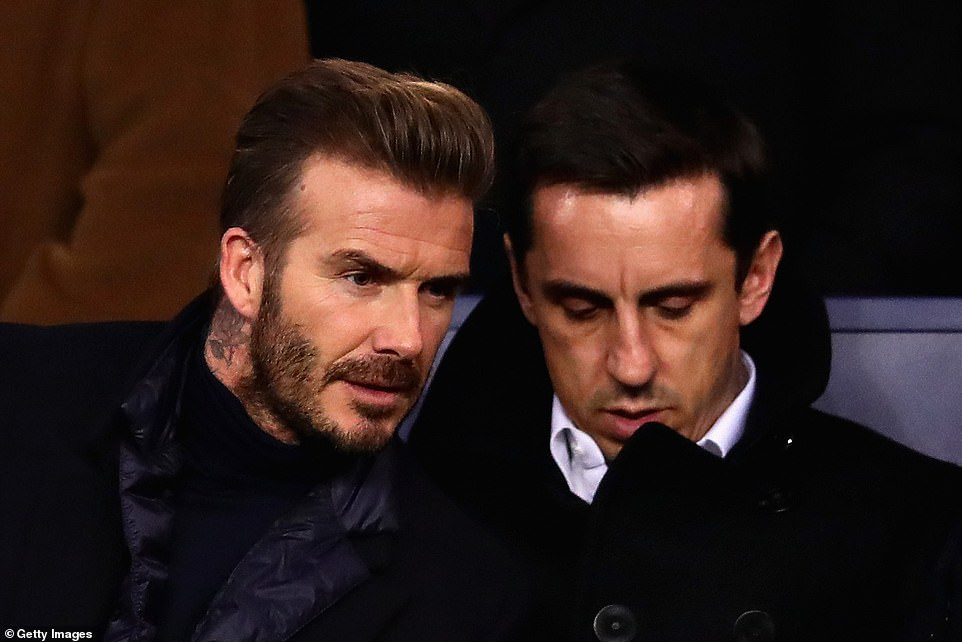 Beckham and Neville looking on from the crowd during the UEFA Champions League Round of 16 second leg match in Paris in 2018. In an interview, Gary admitted that while Becks was staying the former England captain would do all the cooking
