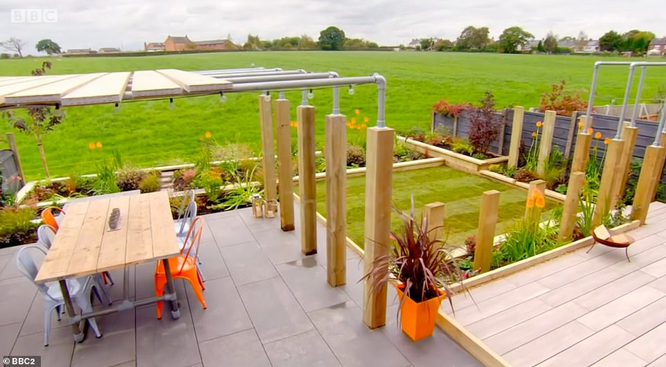 AFTER:A couple had their tired garden transformed into a multi-functional outdoor space in a £30,000 makeover in last night's episode of Your Garden Made Perfect. Pictured, the result of the TV garden makeover