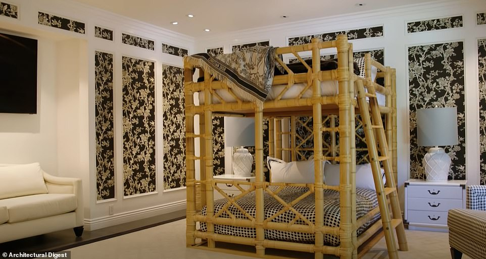 Sleepover! For guests, she has this full-size bunk bed in a room with more bold wallpaper