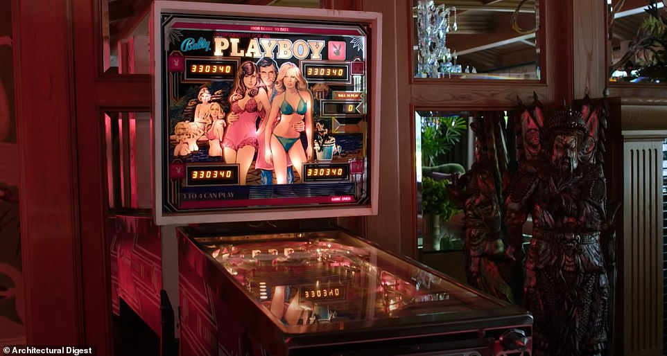 Her game room has arcade machines include a Playboy pinball machine, and Cara admits that 'Hugh Hefner is a big inspiration for this house. This kind of feels like my Playboy mansion'