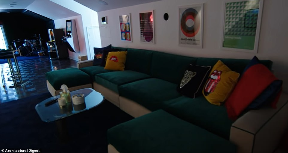 Hangout spot: She has a screening room with a projector and screen that descends from the ceiling