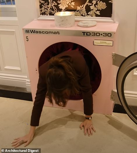 She explained, showing how she can come out on the other side through a washing machine door