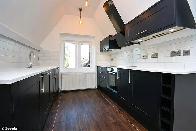 Extra storage solutions in the flat: There are kitchen units cleverly installed under the eaves