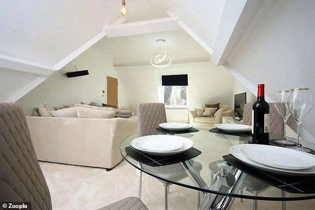 The sale of the flat includes a share of freehold with a lease extension to 999 years and a service charge of £288 a month