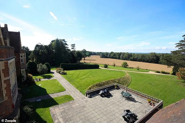 The flat has views across the surrounding views and towards the North Downs in Surrey