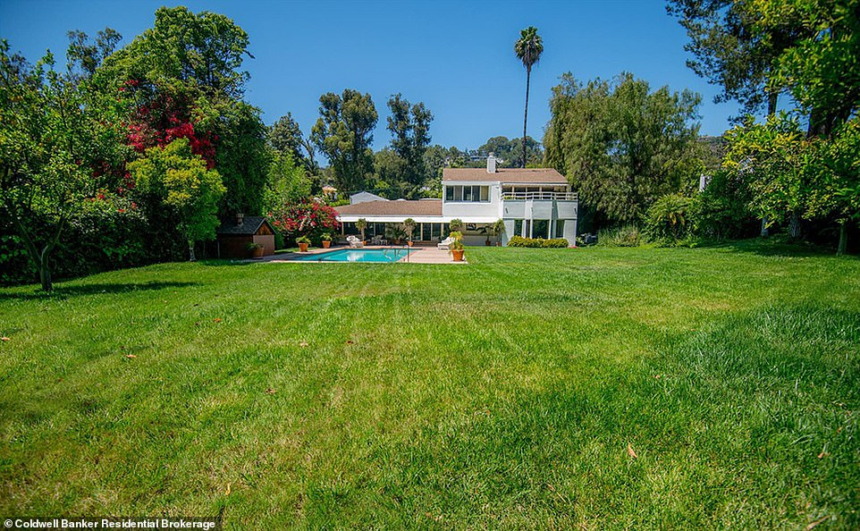 Stunning: Simon's five-bedroom, six-bathroom home in the neighbourhood was initially built in the early 60s and spans 6,045 square feet and sits on nearly an acre