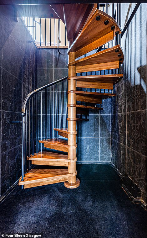 A spiral staircase leads to the entertainment space