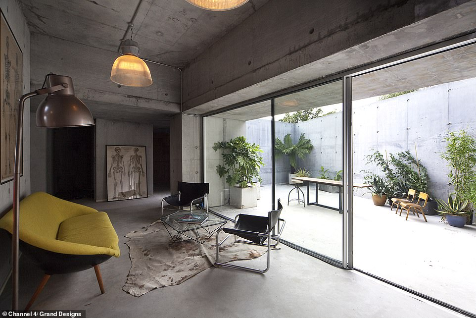 THE LIVING ROOM BEFORE: The couple opt for a pioneering Swiss 'nano-concrete'. The cutting-edge technology uses micro-reinforcing bits of glass fibre and shards of stainless steel to strengthen the concrete