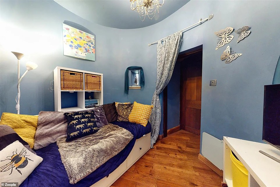Blue walls and ceiling: The second bedroom is in one of the castle's turrets and has space for a single bed and a desk