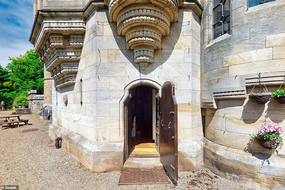 The flat has its own private entrance via a wooden door that is set in the thick stone walls of the castle calledDalzell House