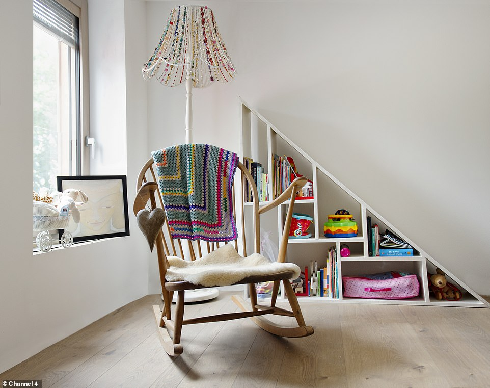 The acutely angled first floor squeezed in a study, a bathroom and two bedrooms (pictured, the colourful nursery)